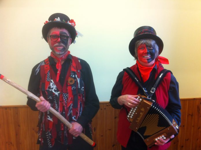 Two morris dancers in costume